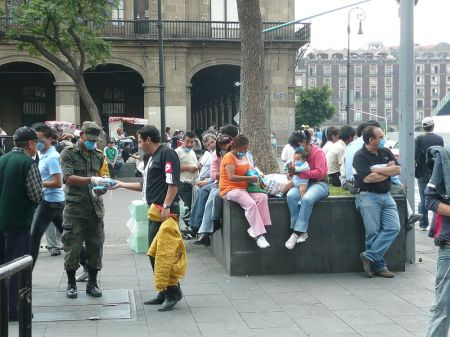 Mexican soldiers issuing the public face masks